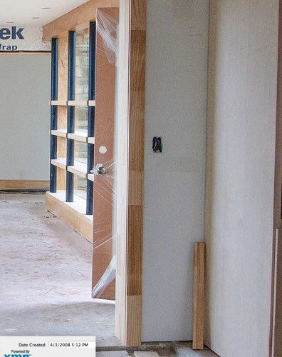 Rutherford Custom Homes' door put outside then sealed in plastic.
