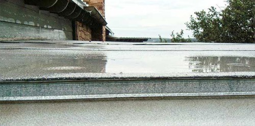 Standing water on Rutherford Custom Homes roof