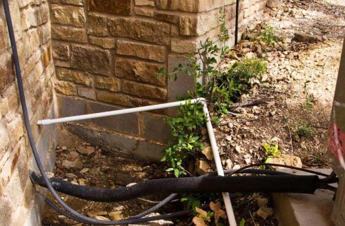 Wimberley builder left water-buildup pit beside foundation