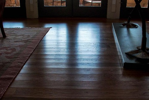 Rutherford Custom Homes took no action that saved wood floor