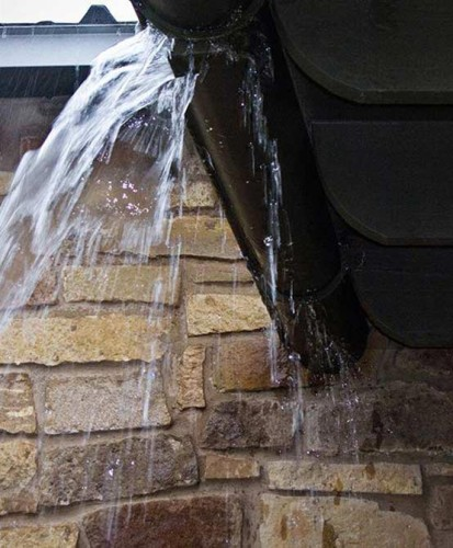 Rutherford Custom Homes' roof directed water to stone walls