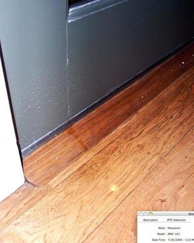 Rutherford Custom Homes' damaged door leaking at seam.