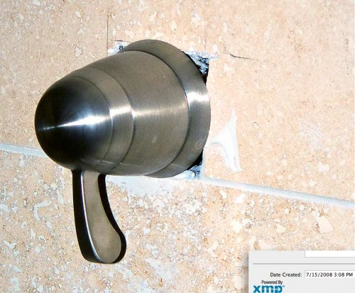 Beau Rutherford's company, Rutherford Custom Homes, took 6 months to fix master bath shower fixture